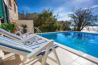 Ferienhaus mit Pool uns Meerblick