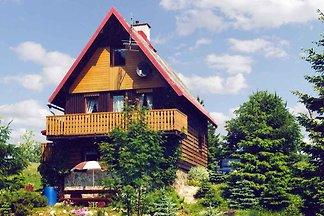 Ferienhaus mit Kamin und Glasveranda