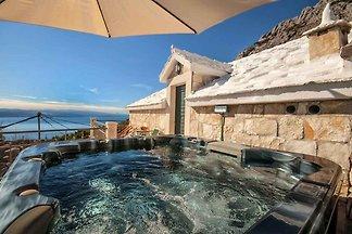 Ferienhaus mit Whirlpool und Meerblick
