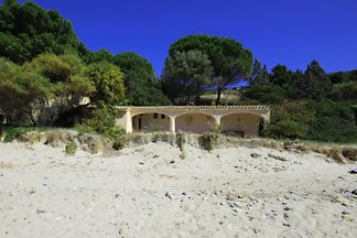 Villa Gennemari on the sandy beach
