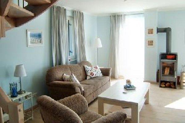 Wohnzimmer mit Kaminofen und Sitzgarnitur