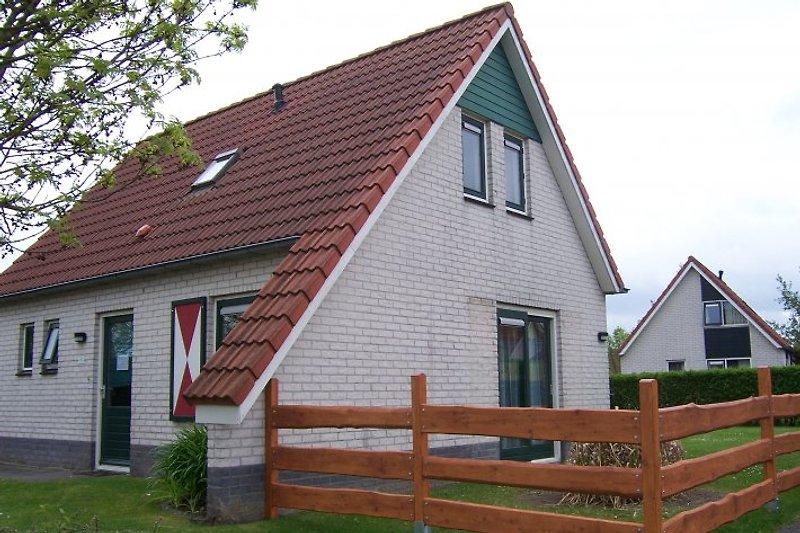 casa individual con jardín y terraza en Breskens - imágen 2