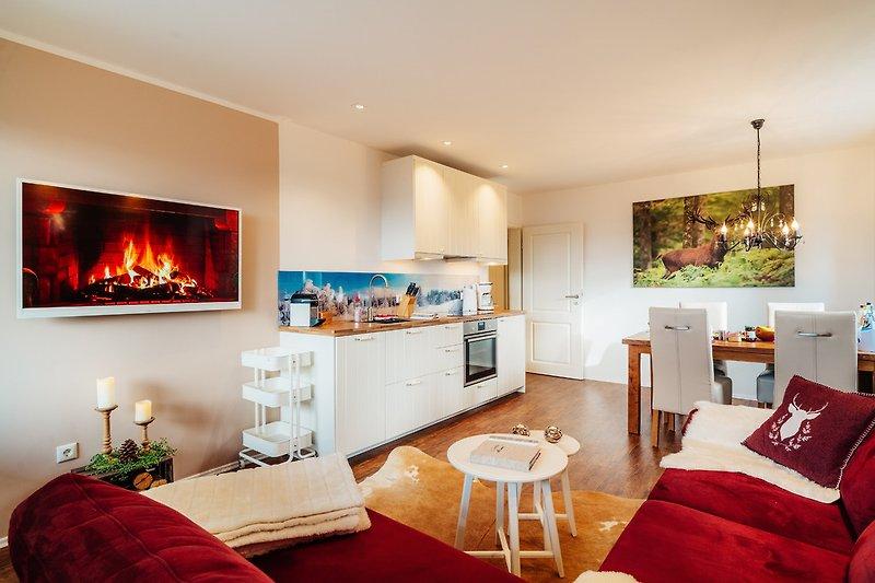 Wohnzimmer mit gut ausgestatteter Küche