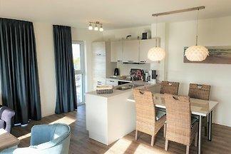 Modernes Apartment, hochwertig ausgestattet, eigene Sauna, Süd-Balkon, direkt am langen Sandstrand! Vom DTV mit 4 Sternen ausgezeichnet!