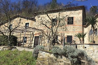 Idyllic hillside Tuscan farmhouse in secluded rural setting with panoramic views of stunning countryside, close to lovely market town and amenities