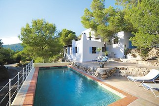 Holiday in Ibiza, nestled between green with ...