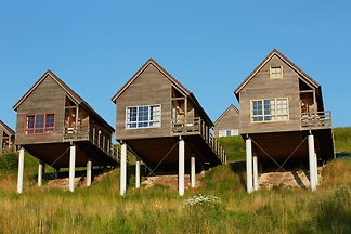 Authentisches Holz-Ferienhaus in ruhiger grün...