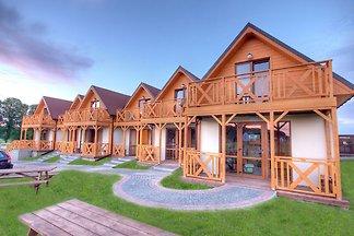Przestronne domki z prywatnym tarasem na ogro...