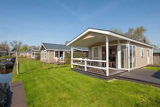 Modern lodge with an electric sloop in centre...