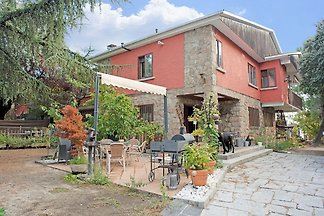 Wohnung mit Garten, Pool und Spa in einem gro...