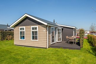 Compact lodge with an electric sloop in...