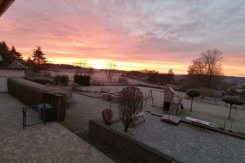 Aussicht Wohnzimmer wenn am morgen die Sonne aufgeht.