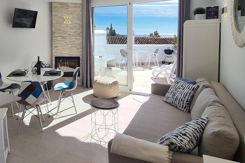Wohnzimmer: Sofa mit 145x200 cm Schlafbereich, TV, Musikanlage, Kamin, Fußbodenheizung etc.