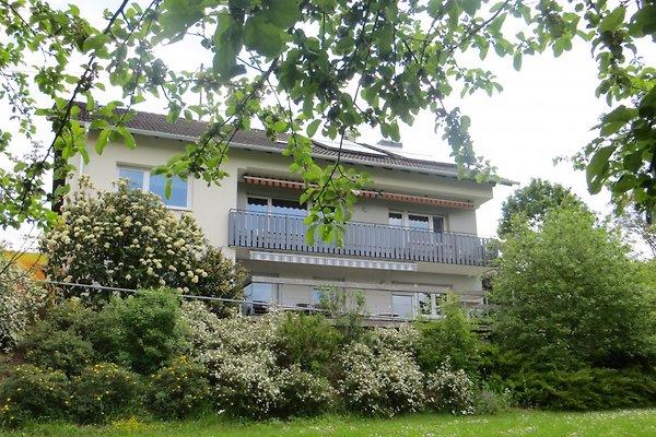 Unser Haus mit Balkon und Terrasse von der Gartenseite