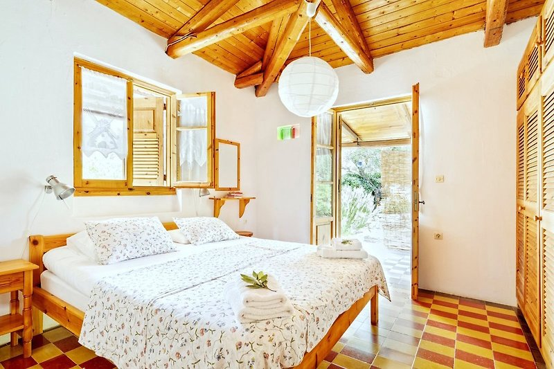Master bedroom with double bed and space for a cot as well.