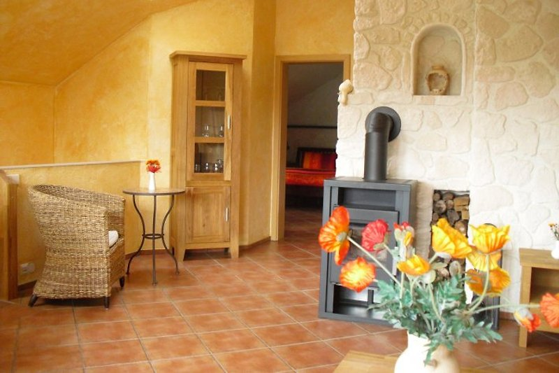 OG: großzügiger Wohnbereich mit Kamin
