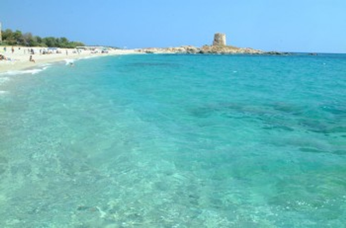 Torre Di Barì Beach A Rocky Headland On Which Stands Spanish Tower Divides It Into