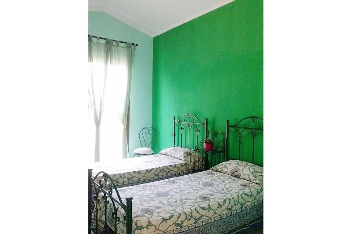Casa roberto direttamente a chia casa vacanze in chia for Case a buon mercato 4 camere da letto