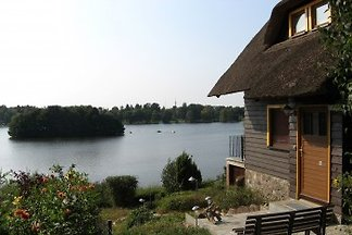 Thatched cottage on the lake