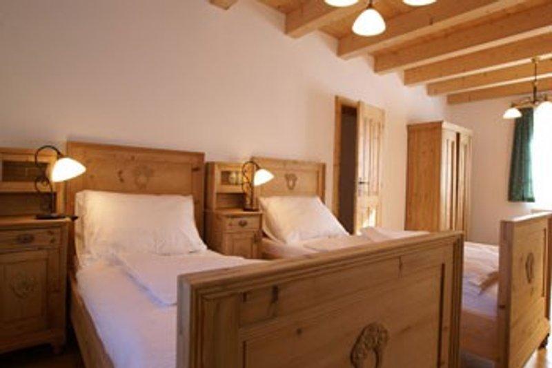 Schlafzimmer mit Doppelbett oder 2 Einzelbetten