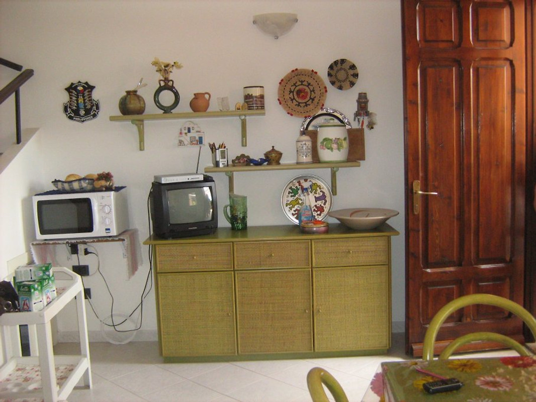 Piccola casa con giardino casa vacanze in santa for Piccola casa con avvolgente portico