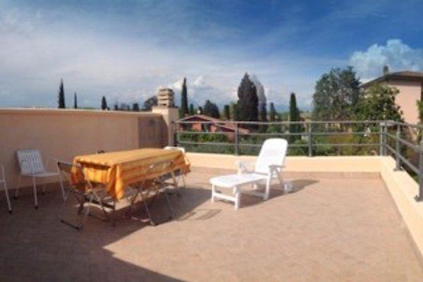 casa vacanza le palme terrasse ferienwohnung in sirmione. Black Bedroom Furniture Sets. Home Design Ideas