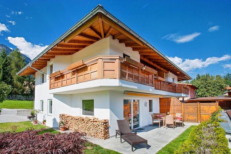 jedes Haus mit eigener Terrasse und Garten
