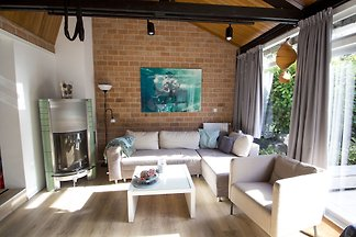 Very well and modern furnished holiday home for 4 persons in the small village Sint Maartenszee in the Netherlands. The bungalow park is within walking distance to the beach.