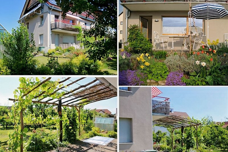 AUSSENANSICHT der Wohnung im ERDGESCHOSS mit Terrasse