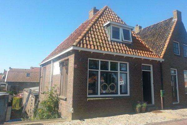 FR147, Maison Hindeloopen. à Warns - Image 1