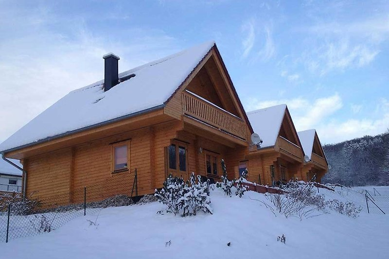 Winterbild Blockhäuser