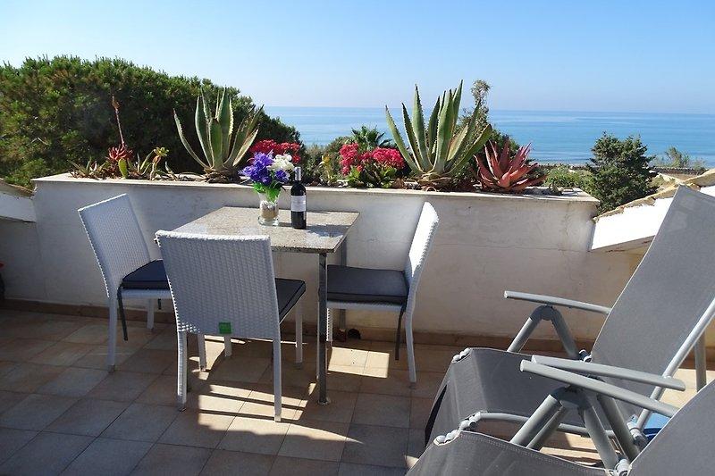 Ferienwohnung mit Meerblick Terrasse