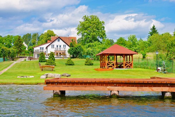 Unsere Haus am Tajty See mit eigener Badestrand, Anglersteg und Gartenhaus.