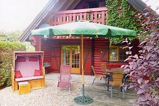 Schwedenrotes komfortabel eingerichtetes Holzbohlenhaus im Ferienpark Otterndorf mit Sauna, Kamin, Ledersofas, Waschmaschine, Trockner, Geschirrspüler auf wunderschönem  Grundstück