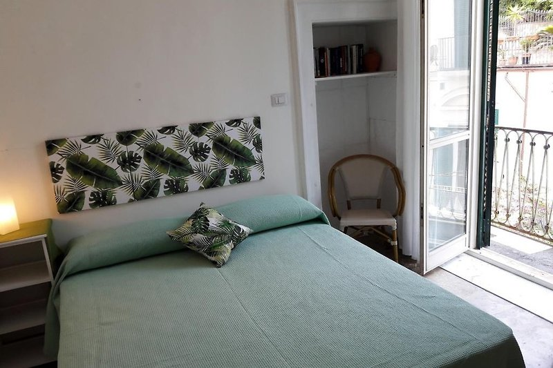 Schlafzimmer  n° 1 mit Balkon und Privatbad