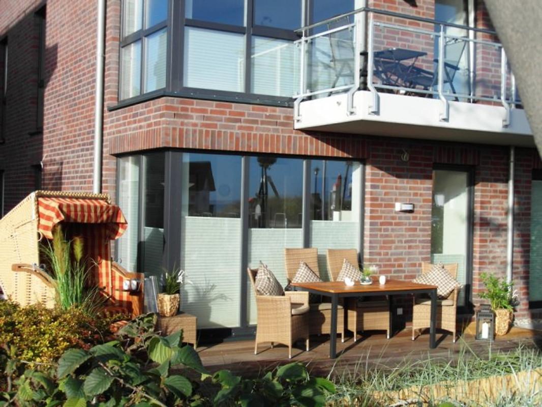 strandhaus garten teilmeerblick ferienwohnung in scharbeutz mieten. Black Bedroom Furniture Sets. Home Design Ideas