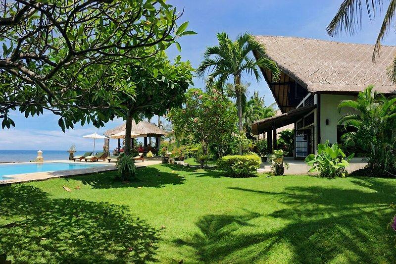 Seaside garden of Villa Rumah Buka
